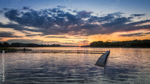 Foto op Canvas Natuur Dynamic sky and sunset at the lake in summer, Poland