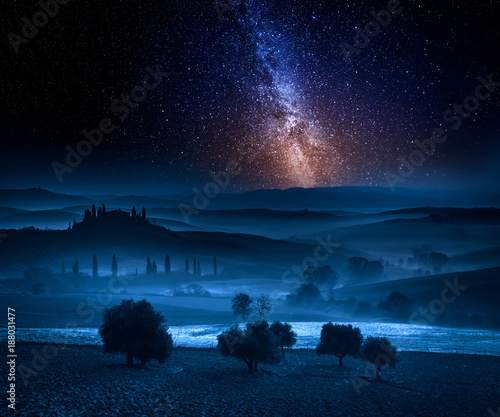 Poster Toscane Milky way over fields in the valley in Tuscany, Italy