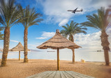Central public beach in Eilat - famous resort city in Israel. Conceptual image symbolizing happy vacation and resting in tropical environment - 188037404
