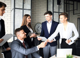 Business people shaking hands, finishing up a meeting. - 188044228