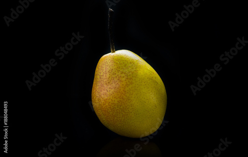 Foto Murales Pear isolated on black background. Selective focus. Shallow depth of field.
