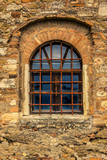 Detail of a medieval window of an old castle in Tuscany