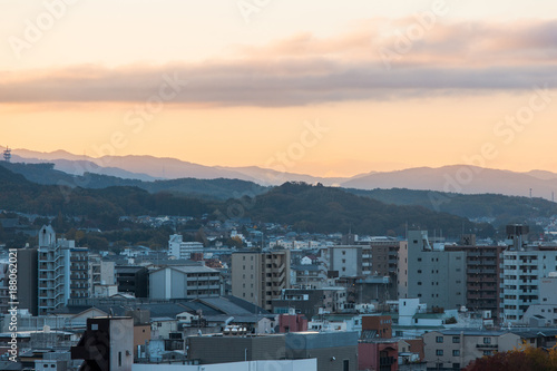 Fotobehang Kyoto Kyoto city view with mountain range on the background.