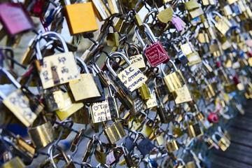 Love locks attached on a bridge in Paris, France