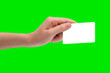 Hand hold business card, credit card or blank paper isolated on green background with clipping path.