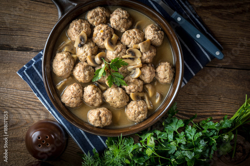 Fotobehang Bol Delicious homemade swedish meatballs with mushroom cream sauce. Small depth of field. Top view.