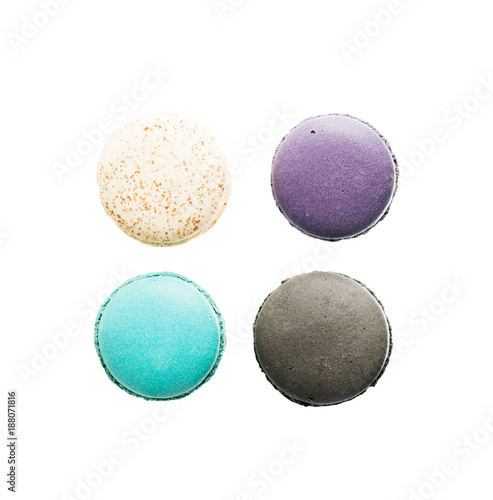 Fotobehang Macarons Flat lay top view four Colorful macarons on white background. Minimal pattern, creative dessert concept
