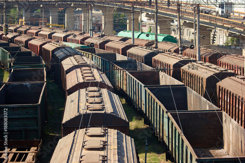 Fototapeta Perspective view cargo freight trains depot. Many freight train wagons.