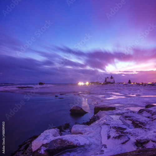 Foto op Canvas Violet Snow-covered shore of the Barents Sea in purple polar night, Karelia, Russia