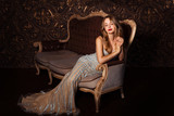 Fashion portrait of attractive woman in elegant dress posing indoors in sensual way - 188091898