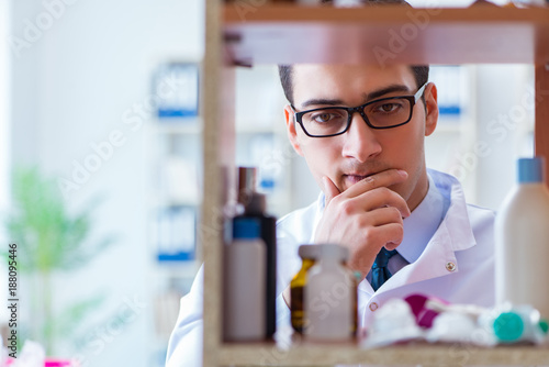 Poster Apotheek Doctor at farmacy retail shop looking for medicines
