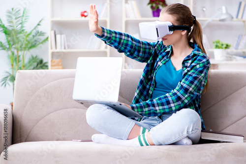 Female student sitting on the sofa with virtual glasses