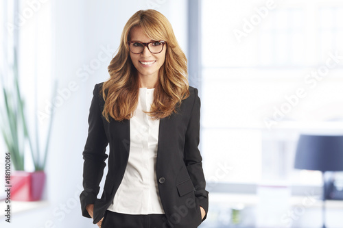 Sticker Successful in the business life. Executive middle aged businesswoman portrait