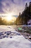 frozen river among c...