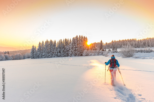 Height scale Sunny winter landscape with man on snowshoes.