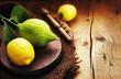 Bergamot with lemons on old rustic background.
