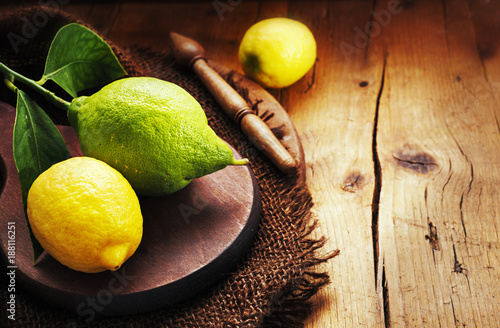 Bergamot with lemons on old rustic background. - 188116251