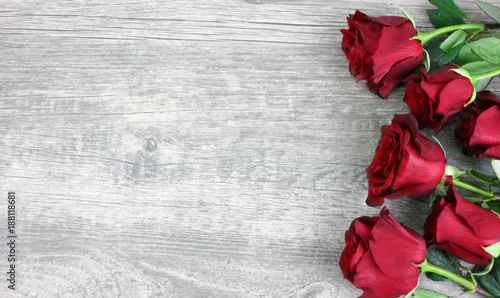 Beautiful Red Roses Still Life Over Rustic Wooden Background, Love Concept, Shot From Above © IrisImages