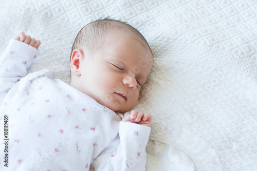 Foto Murales a newborn has a healthy day's sleep. sweet dreaming. happy motherhood. copy space concept.