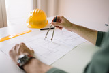 Close up of construction engineer using compass drawing tool - 188134240