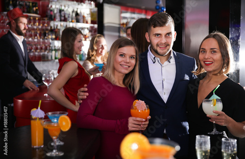 Man and two women at nightclub