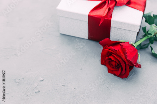Beautiful red rose and gift box on wooden background with copy space. valentine's day present.
