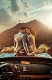Romantic couple sitting on the bonnet - 188141056