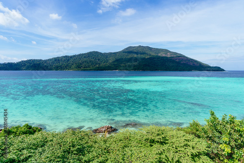 Beautiful seascape with crystal clear water, blue sky and island in background - 188145434