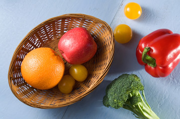 Fruits and Vegetables on Blue Painted Wood Horizontal Image
