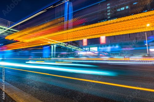 traffic with blur light through city at night. - 188152233