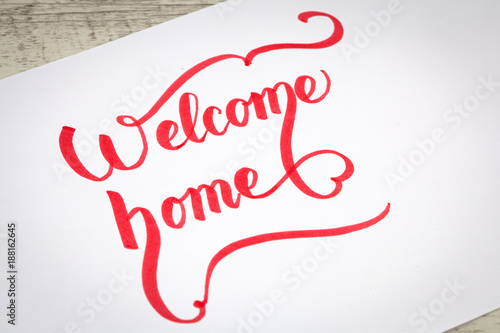Foto Murales Welcome Home creative brush lettering in red color