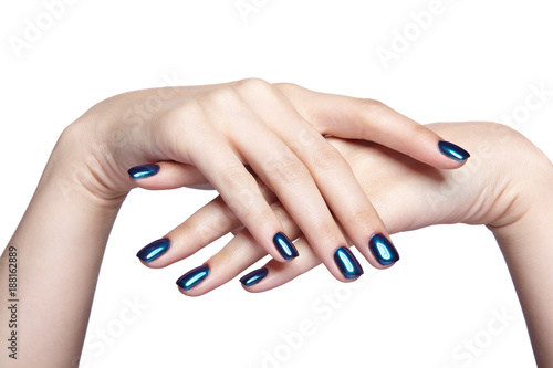 Foto op Canvas Manicure Female hands with blue and shiny nails manicure isolated on white