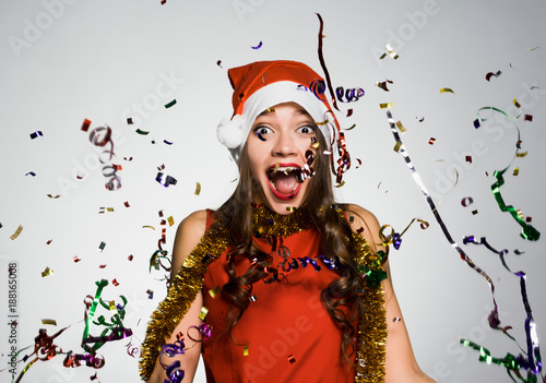 woman on a white background having fun celebrating the new year
