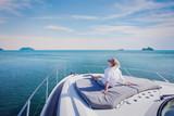 beautiful woman enjoying luxurious yacht cruise, sea travel by luxury boat - 188167420