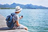 tourist traveler using mobile phone, smartphone app for traveling - 188170235