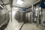 A long gangway between two rows of cisterns. Storage of food liquids. - 188175278