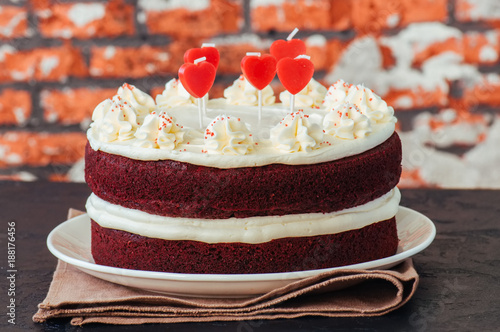 Foto Murales Red velvet cake with cream cheese frosting on a white plate