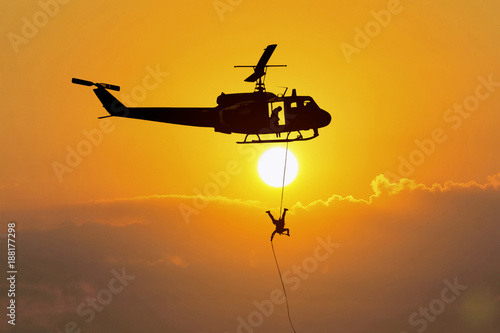 Fototapeta Soldiers rescue helicopter operations on sky
