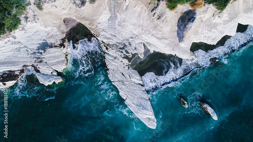 Foto op Plexiglas Cyprus Aerial view of landmark big white chalk rock at Governor's beach caves, Limassol, Cyprus. The steep stone cliffs and deep blue sea waves crushing in coves and dark sand from above.