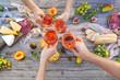 Leinwandbild Motiv Young people making toast at picnic with rose wine