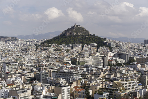 Fotobehang Athene Athens, Greece Mount Lycabettus day view. Panoramic view of Lykavittos hill and surrounding cityscape buildings from Athens Acropolis.