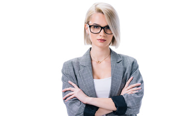attractive businesswoman in eyeglasses with crossed arms, isolated on white