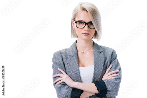 Zobacz obraz attractive businesswoman in eyeglasses with crossed arms, isolated on white