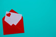 Red envelope with love letter above blue background with red heart. Love Letter. Love concept