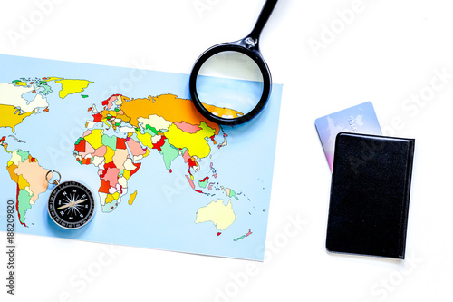 Foto Murales Planning trip. World map, compass and bank card on white backgro