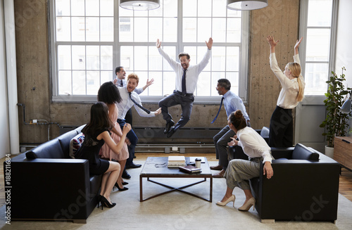 Height scale Business team jump for joy at hitting target in meeting