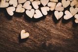 Wooden hearts on dark wooden background