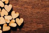 Valentine's Day background. Wooden hearts.