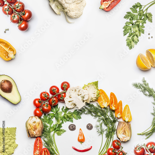 Foto Murales Healthy lifestyle concept. Various fresh vegetables with funny face made with ingredients on white background, top view, frame. Layout for Detox, dieting and clean eating food