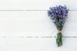 Lavender flowers on white wooden background